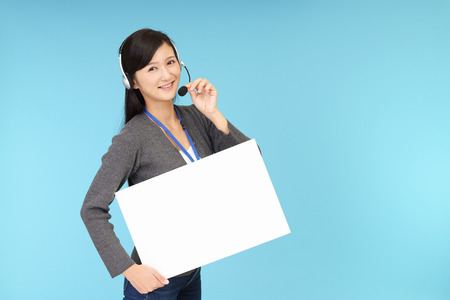 telephone call: Smiling call center operator