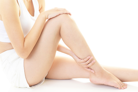barefoot women: Woman who takes care of her legs Stock Photo