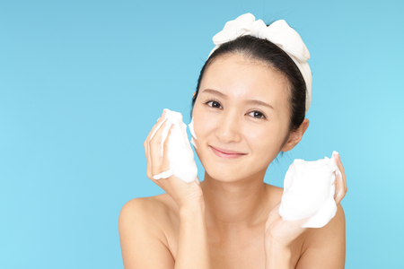 happy faces: Woman washing her face Stock Photo