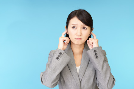 Woman who holds her ears Stock Photo