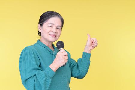 frailty: Old woman singing karaoke