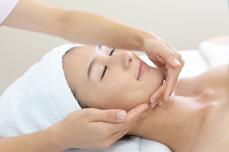 esthetician: Woman getting a facial massage Stock Photo