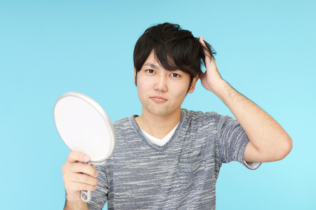 dissatisfied: Dissatisfied Asian man Stock Photo