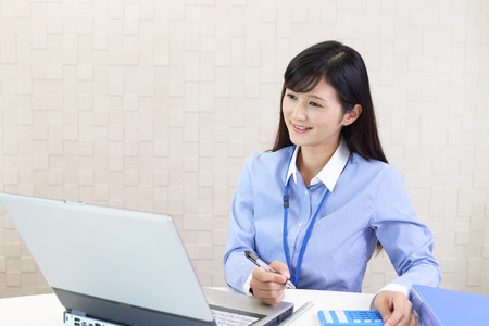 business ideas: Business woman working on a laptop
