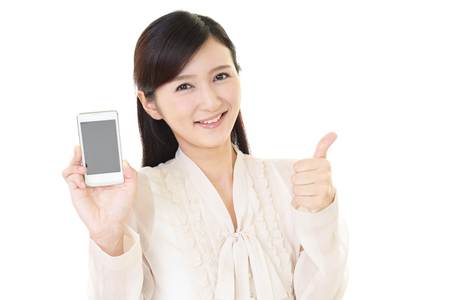 mobile phone screen: Smiling young woman