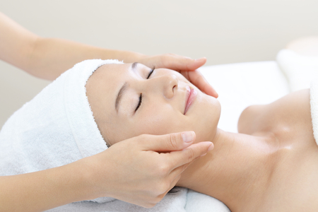 facial hair: Woman getting a facial massage Stock Photo