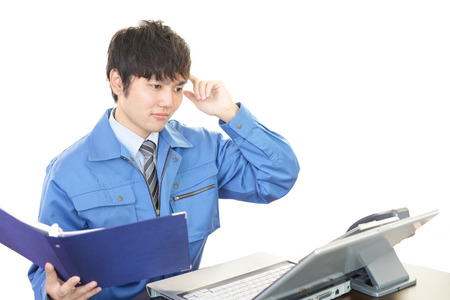 uneasy: Asian worker in an uneasy look Stock Photo