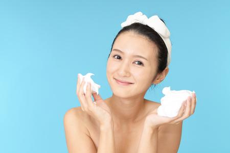 washing face: Woman washing her face Stock Photo