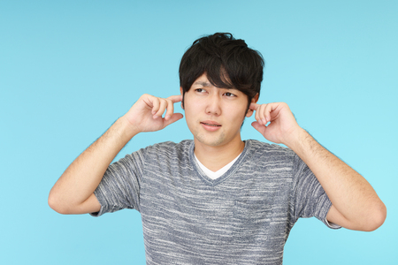 bother: Man who holds his ears Stock Photo