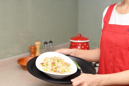 enjoys: Housewife who enjoys cooking Stock Photo