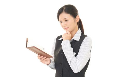checks: Woman who checks the schedule