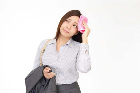 汗を拭く女 写真素材