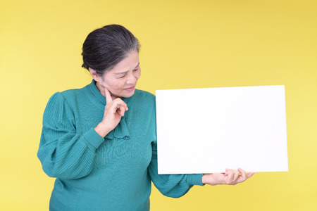 frailty: Old woman with a board Stock Photo