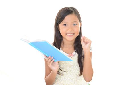 schoolroom: Smiling Asian girl Stock Photo