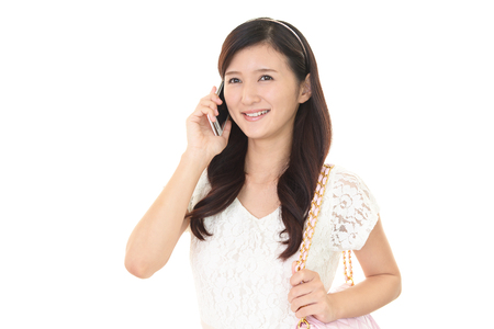 woman at the phone: Woman using a smart phone