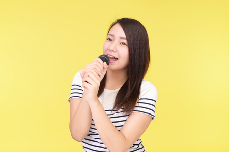 Woman singing karaoke Stock Photo