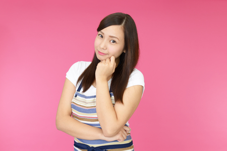bright housekeeping: Portrait of an Asian housewife Stock Photo