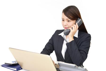 携帯電話を持つ女性実業家 写真素材