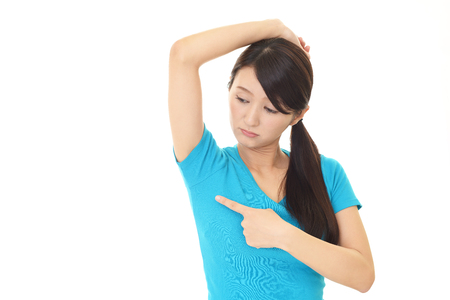 adult armpit: Young woman having sweating problem