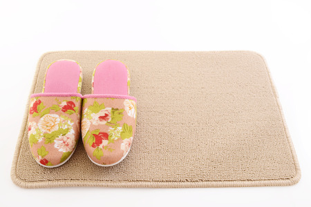 foot ware: Slippers on the mat Stock Photo