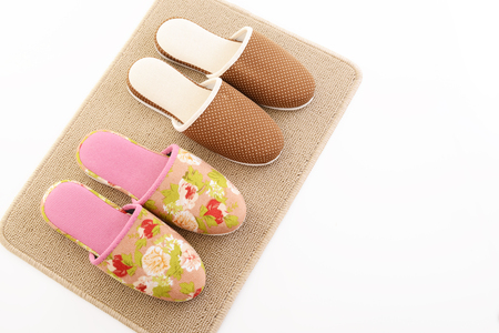 insoles: Slippers on the mat Stock Photo