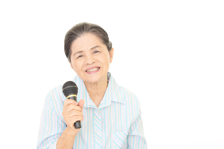 health concern: Old woman singing karaoke