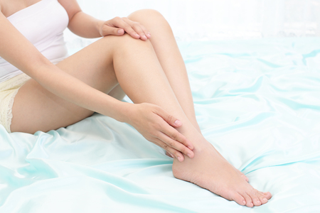 bodypart: Woman who takes care of her legs Stock Photo