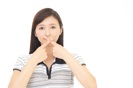 solicitude: Woman covers her mouth Stock Photo