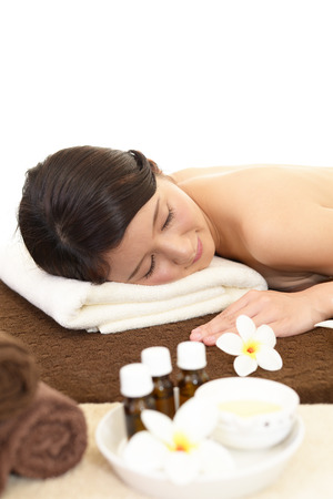eustachian: Young woman lying on massage table at spa Stock Photo