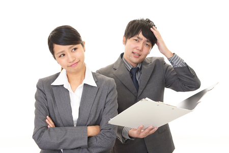 dissatisfied: Dissatisfied businessman and businesswoman Stock Photo
