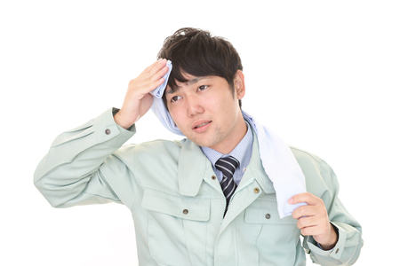 sunstroke: Tired and stressed Asian worker Stock Photo