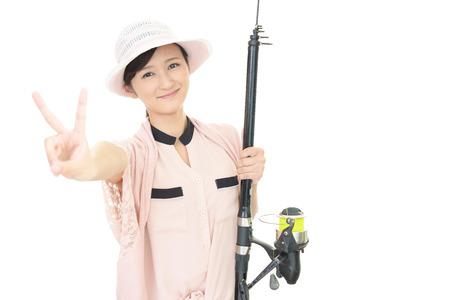 Woman with fishing tackle