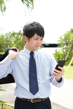 telephone salesman: Businessman holding a smart phone Stock Photo