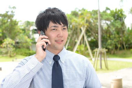 telephone salesman: Businessman who is talking on a smart phone Stock Photo