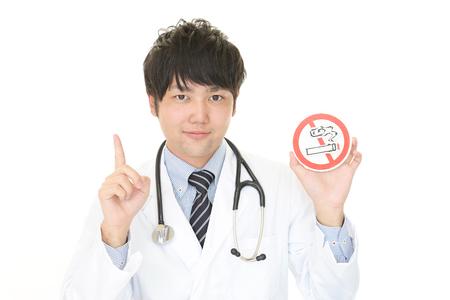 non  smoking: Doctor holds non smoking sign