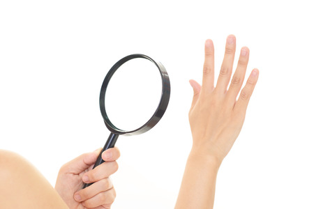 palm reading: Woman hand with a magnifying glass