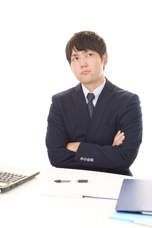 dissatisfied: Dissatisfied Asian businessman