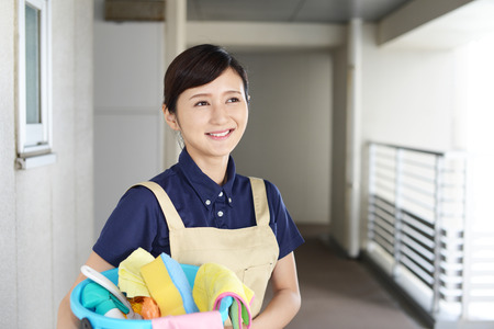 Woman with cleaning tools Stock Photo