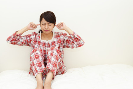 anaerobic: Woman who holds her ears Stock Photo