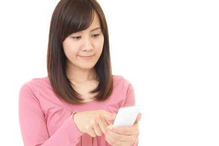 operates: The woman who operates a smartphone Stock Photo