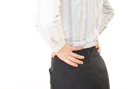 low back pain: Woman of the low back pain Stock Photo