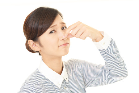 solicitude: Woman pinches her nose