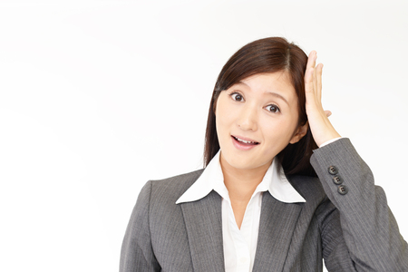 embarrassment: Business woman who is surprised