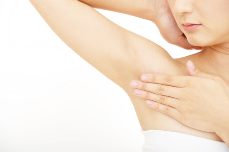 armpits: The woman who is doing skin care.