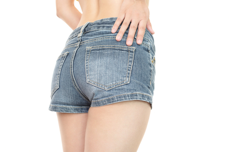 Sexy woman in fashion blue jeans shorts Stock Photo