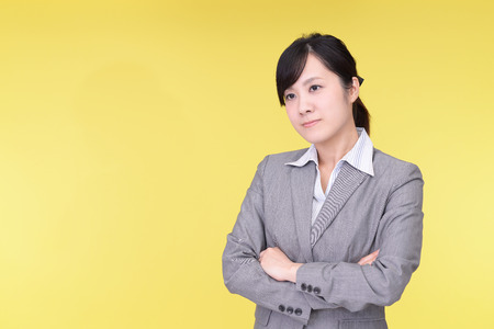 anaerobic: Uneasy Asian business woman Stock Photo