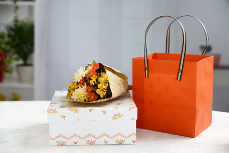 Gift boxe with flower bouquet Stock Photo