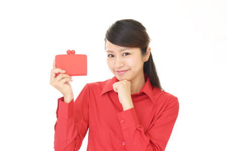 Smiling young woman with purse