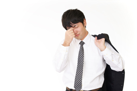 tired businessman: The man with eyestrain