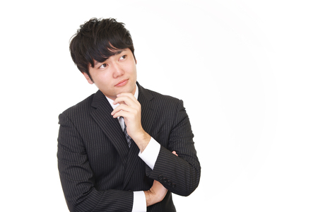 tired businessman: Uneasy Asian businessman